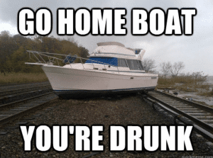 """Boat on railroad tracks with text """"Go home boat, you're drunk"""""""